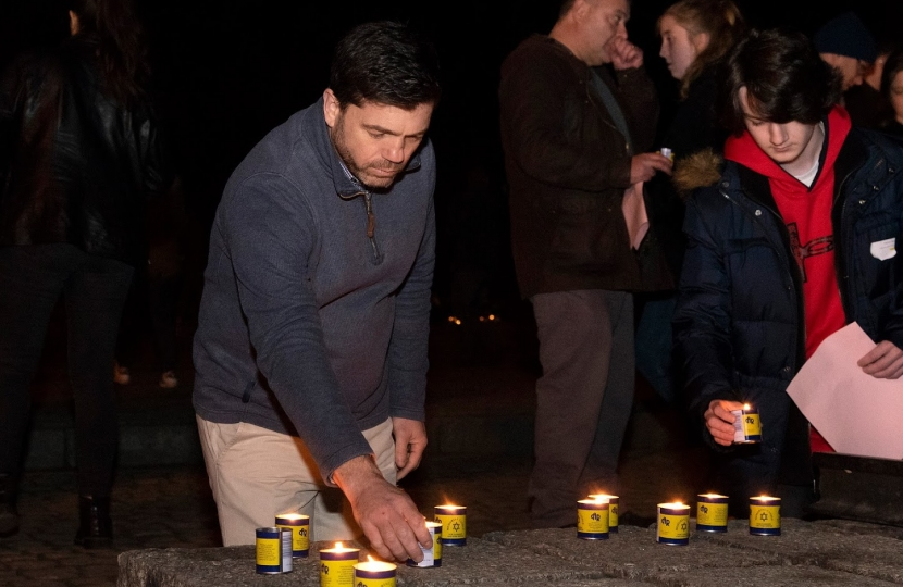 Stephen Crabb lighting a candle in memory of Holocaust victims